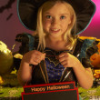 Halloween party with a child holding sign — Stock Photo