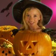 Halloween party with a child holding carved pumpkin — Stock Photo