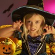 Halloween party with a child wearing scaring costume — Stock Photo #11879557