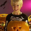 Stock Photo: Halloween party with a boy holding carved pumpkin