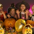 Halloween party with children wearing fancy costumes — Stock Photo