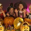Foto Stock: Halloween party with children wearing fancy costumes