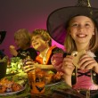 Stock Photo: Halloween party with children having fun in fancy costumes