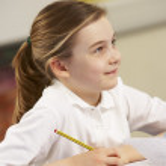 Schoolgirl Studying In Classroom — Stock Photo