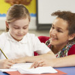 Schoolgirl Studying In Classroom With Teacher — Stock Photo