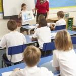 Schoolchildren Studying In Classroom With Teacher — Stock Photo #11879682