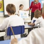 Schoolchildren Studying In Classroom With Teacher — Stock Photo