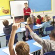 Schoolchildren Studying In Classroom With Teacher — Stock Photo #11879690