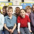Schoolchildren In classroom — Stock Photo #11879700