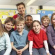 Schoolchildren In classroom with teacher — Stock Photo