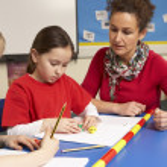 Schoolchildren Studying in classroom with teacher — Stock Photo #11879719