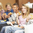 Group Of Teenage Friends Sitting On Sofa At Home Eating Fast Foo — Stock Photo