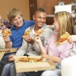Group Of Teenage Friends Sitting On Sofa At Home Eating Pizza — Stock Photo