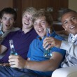 Group Of Teenage Boys Sitting On Sofa At Home Watching Drinking — Stock Photo #11879995