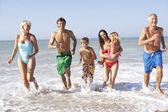 Three generation family play on beach — Stock Photo
