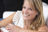 Studio Portrait Of Teenage Girl Listening to MP3 Player — Stock Photo