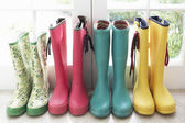 A display of colorful rain boots — Stockfoto
