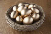 A basket of golden eggs — Stock Photo