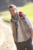 Young man poses in park — Stock Photo