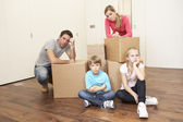 Young family looking upset among boxes — Stock Photo