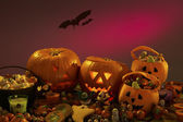 Halloween party decorations with carved pumpkins — Stock Photo