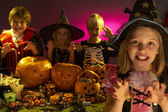 Halloween party with children wearing scaring costumes — Stock Photo