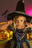 Halloween party with a child wearing scaring costume — Stock Photo