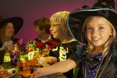 Halloween party with children having fun in fancy costumes — Stock Photo