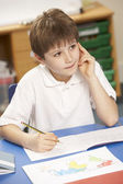 Schoolboy Studying In Classroom — Stock Photo