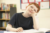 Schoolboy Daydreaming In Classroom — Stock Photo