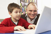 Schoolboy In IT Class Using Computer With Teacher — Stock Photo