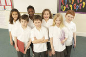 Portrait Of Schoolchildren Standing In Classroom — Stock Photo