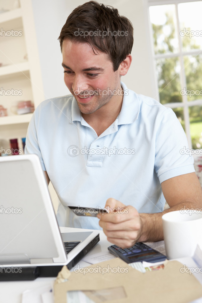 Young man using credit card on the internet — Stock Photo #11879516