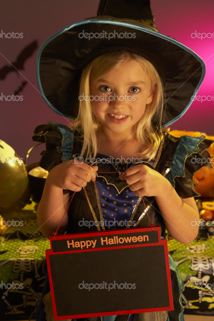 Halloween party with a child holding sign — Stock Photo #11879554