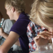 Group Of Teenage Boys And Girls Taking Drugs At Home — Stock Photo