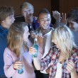 Group Of Teenage Friends Dancing And Drinking Alcohol — Stock Photo