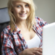 Teenage Girl Using Laptop At Home — Stock Photo #11880149