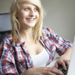 Teenage Girl Using Laptop At Home — Stock Photo
