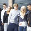 Stock Photo: Group Of Teenagers Hanging Out Together Outside