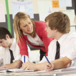 Stock Photo: Teenage Students Studying In Classroom With Teacher