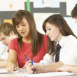 Teenage Students Studying In Classroom With Teacher — Stock Photo