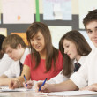 Teenage Students Studying In Classroom With Teacher — Stock Photo #11880188