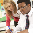 Stock Photo: Teenage Student Working In Classroom With Teacher