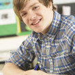 Male Teenage Student Studying In Classroom — Foto de Stock