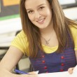 Female Teenage Student Studying In Classroom — Stock Photo
