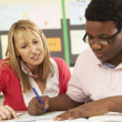Male Teenage Student Studying In Classroom With Teacher — Stock Photo #11880273