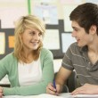 Male And Female Teenage Students Studying In Classroom — Stock Photo #11880283