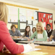 Teenage Students Studying In Classroom With Teacher — Stock Photo #11880294