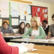 Teenage Students Studying In Classroom With Teacher — Stock Photo #11880297