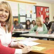 Teenage Students Studying In Classroom With Teacher — Stock Photo #11880300